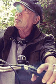 Senior asian man riding his bicycle — Foto de Stock
