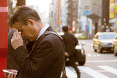 Businessman checks his mobile phone — Stock Photo