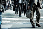 People commuting in rush hour at zebra crossing — Stock Photo