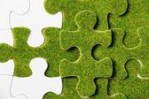 Green puzzle piece — Stok fotoğraf