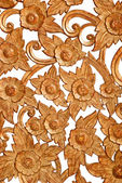 Pattern of rose carved on wood — Stock Photo