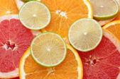 Citrus slices background — Stock Photo