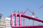 Pink pipelines over blue sky background — Stock Photo