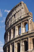 Coliseum on the background of blue sky in Rome — Stock Photo