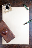 Vintage desk and paper — Stock Photo