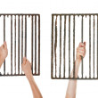 Hands on jail grating — 图库照片