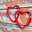 Two red heart at cracked boards — Stock Photo