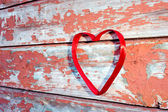 Red heart at cracked boards — Stock Photo