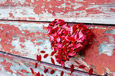 Petals heart and planks — Stock Photo