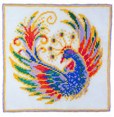 Embroidery depicting the fabulous bird — Stock Photo