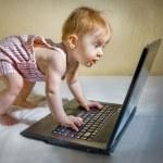 Child using a laptop — Stock Photo