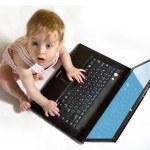 Child using a laptop — Stock Photo #14604807