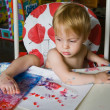 Painting child — Stockfoto