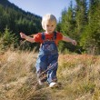 Child in forest - Stock Photo