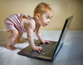 Child using a laptop — Stock Photo
