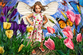 Cute little girl with butterfly wings in flowers — Stock Photo