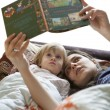 Mother reading book — Stock Photo