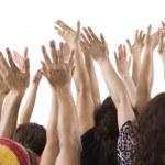 Men and women raising hands — Stock Photo #34638685