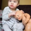 Baby girl with baby doll — Stock Photo #34638649