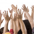 Men and women raising hands — Stock Photo
