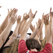 Men and women raising hands — Stock Photo #34638689