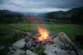 Camp fire in the mountains. — Stock Photo