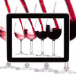 Stock Photo: Digital Tablet with Red wine splashing