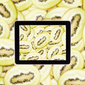 Kiwi on tablet computear screen — Stock Photo