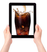Coke on a tablet screen — Stock Photo