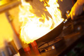 Chef is making flambe — Stock Photo