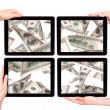Lot of money on a Tablet pc screen — Stock Photo