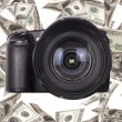 Photo camera with money — Stock Photo