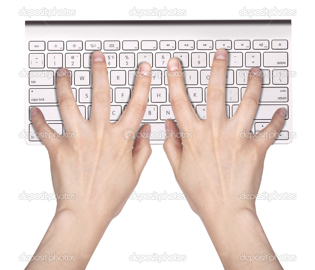Hands typing on the remote wireless computer keyboard in an office at a workplace isolated on a white background — Stock Photo #14878321