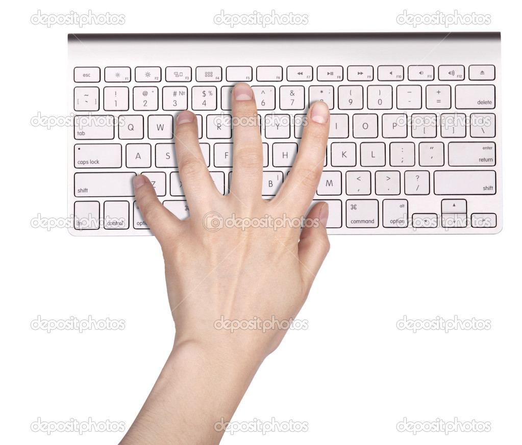 Hands typing on the remote wireless computer keyboard in an office at a workplace isolated on a white background  Stock Photo #14878327
