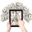 Lot of money on a Tablet pc screen - Stock Photo
