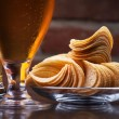 Glass of Fresh Beer and plate with chips — Stock Photo