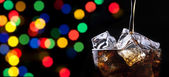 Party background with splashing cola — Stock Photo
