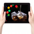 Party background with cola on a digital tablet — Zdjęcie stockowe