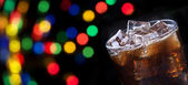 Party background with splashing cola — Stockfoto