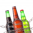Alcohol abuse concept - beer locked on a chain — Stock Photo