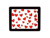 Na zeleném pozadí na displej digitální tabletu — Stock fotografie