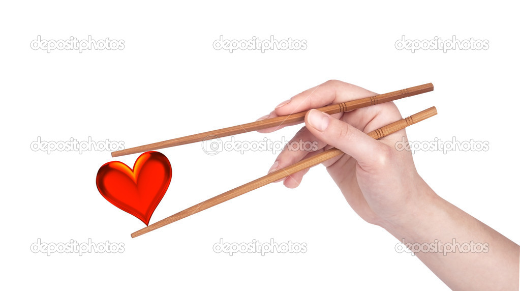 Love Concept With Woman Hand Heart And Chopsticks Stock