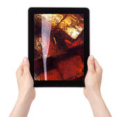 Fresh cola with ice on a diital tablet screen — Stock Photo