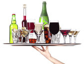 Different alcohol drinks on a tray — Stock Photo