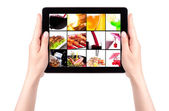 Meat dishes and alcohol on a tablet screen — Stock Photo
