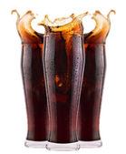 Fresh cola drink background with splash — Stock Photo
