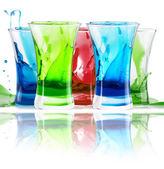Alcoholic shot cocktails stack with splash — Stock Photo
