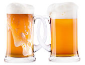 Two beer mugs being attached to each other — Stock Photo