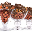 Chocolate Flowing over nuts in a glass Isolated — Stock Photo #24602727