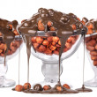 Chocolate Flowing over nuts in a glass  Isolated — Stock Photo